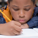 Student having difficulty writing while doing school work, expressing symptoms of Dysgraphia.