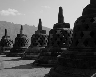 Each of these stone bells at a temple in Indonesia houses its own Buddah