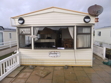 Severe damage to this static caravan's exterior