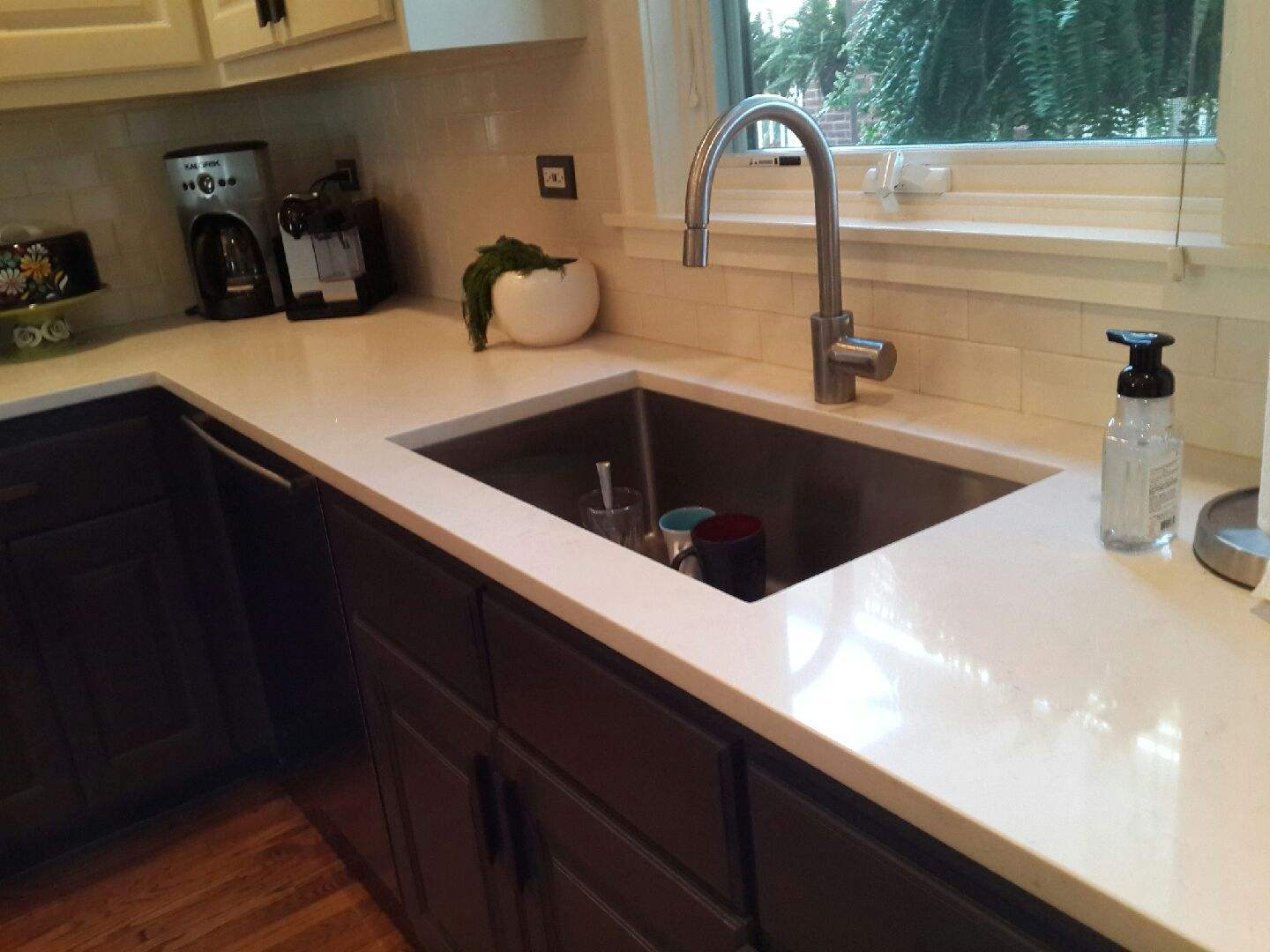 Beige Caesarstone Countertops With Dark Cabinets