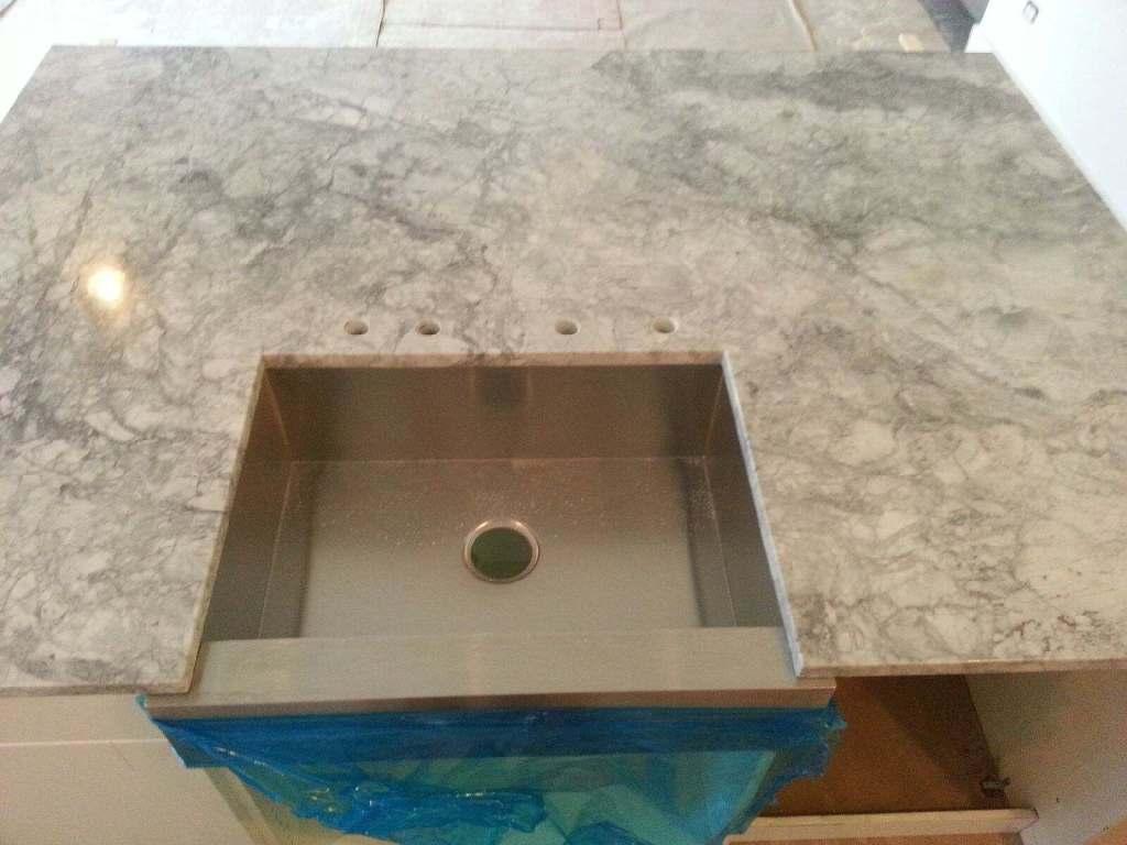 Farmer sink in granite countertop island