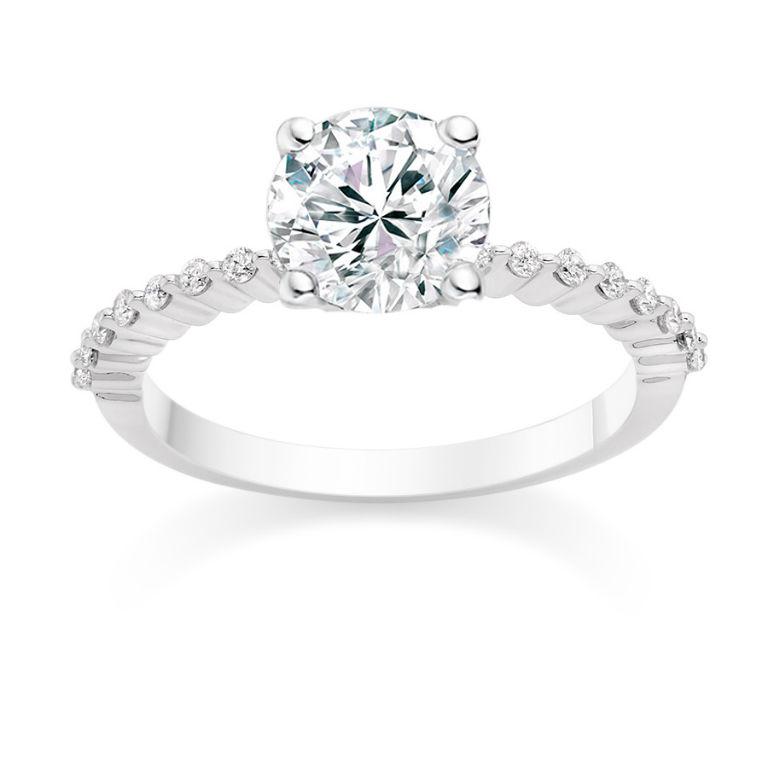 7 - Round cut 0.67 carat side stones engagement ring in platinum