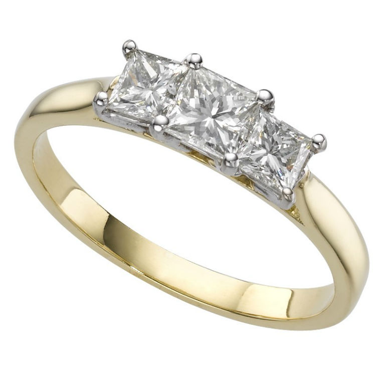 8 - Graduated three stone ring in 18 carat gold with 1 carat diamond