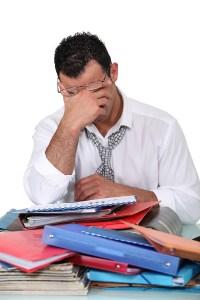 bigstock-Overworked-employee-38800729