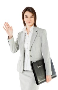bigstock-Smiling-businesswoman-on-white-25334750