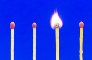 Burning Match Setting On Blue Background For Ideas And Inspirati