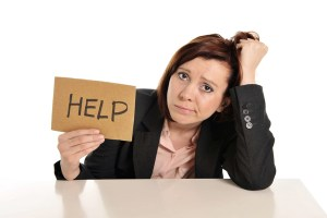 Woman In Stress At Work Asking For Help