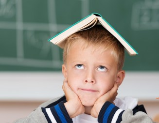 Little Boy Hoping To Absorb Knowledge