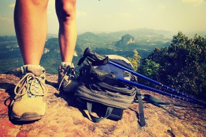 Woman hiker at mountain peak rock