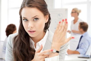 business and time management concept - businesswoman pointing at
