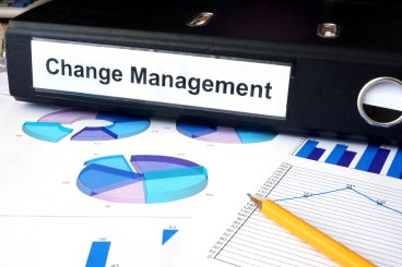Graphs and file folder with label  Change Management.