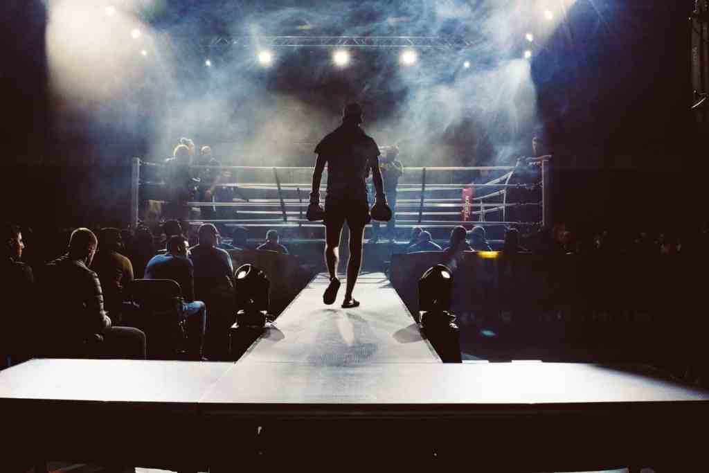 Boxer confidently walking towards the ring
