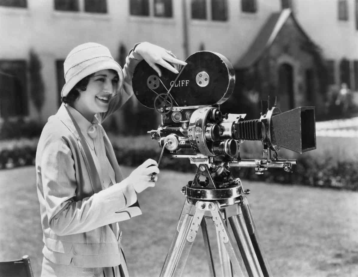 Woman happily working wiht camera