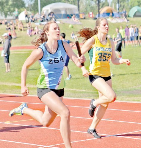 Maddy Vollmer of Loreburn is seen carrying the baton during the senior girls relay race at the provincial track meet in Yorkton.
