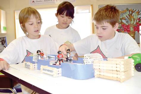 Classmates Brennan Kakakaway and Hayoung Ryu check out Morgan Tastad's miniature hockey rink at Loreburn Central School. Students in Shauna George's Grade 3/4 class displayed their individual Genius Hour projects to visitors during the school's Leadership Day on Wednesday morning.