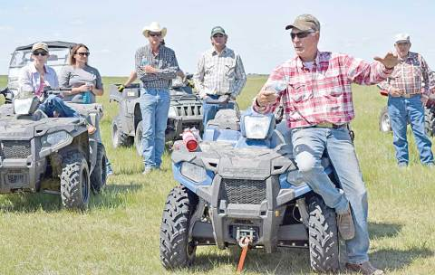 Pasture manager Ross Sigfusson speaks to guests during a tour of the Willner-Elbow community pastures on June 6.