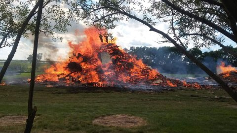 The remains of the Prpick family's barn are destroyed by fire on July 29 after being demolished.