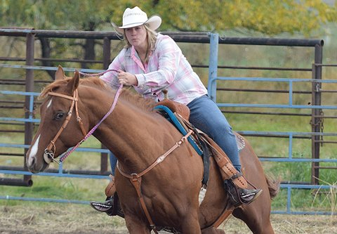 "Beth Manz is seen riding ""Jet"" in the barrel racing jackpot competition at Elbow on Oct. 1."
