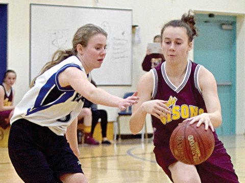 Davidson's Elena Nykiforuk attempts to stop LCBI's Maia Jorgensen during a senior girls basketball game on Wednesday.