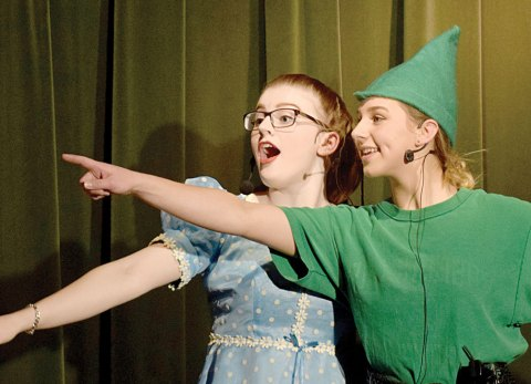 """Wendy (Lexi Lewis) and Peter Pan (Jenna Joa) survey the sights as they fly through the night sky in Imperial School's production of """"Peter Pan."""""""