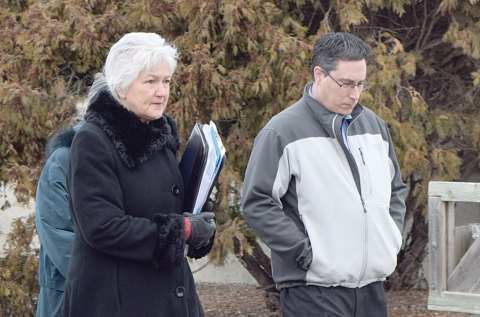 Jeff Murray, former administrator for the Town of Craik, leaves Moose Jaw provincial court on Wednesday morning with his lawyer, Gail Wartman.