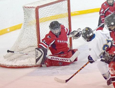 Davidson goalie Daxton Tichit stops a shot by Kash Ringdal.