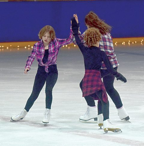 "From left, Erika Swedberg, Emmerson Tastad and Jordyn Dorward skate in a circle to the theme from ""Footloose"" at the Line 19 Figure Skating Club carnival on March 5."