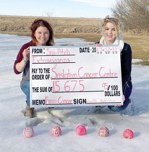Organizers Robyn Libke and Madison Prosofsky pose with a giant cheque for $15,675.95, representing the proceeds from this year's Hanley Sno-Pitch Extravaganza on Feb. 11.