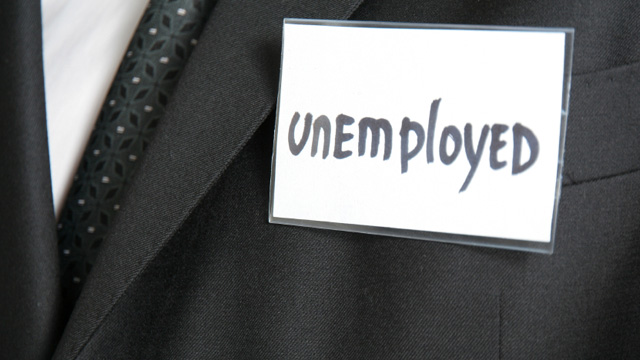 A suit-wearing torso with a name badge that says unemployed.