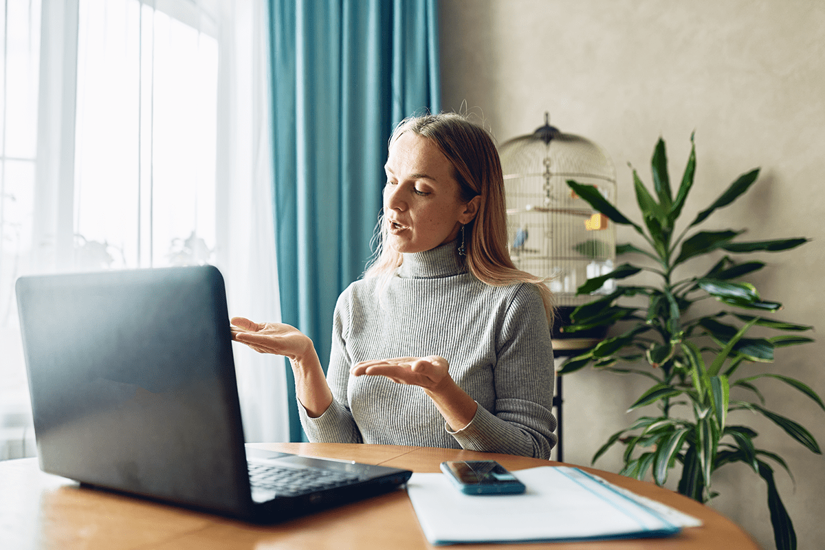 A woman chats with her online executive coach.