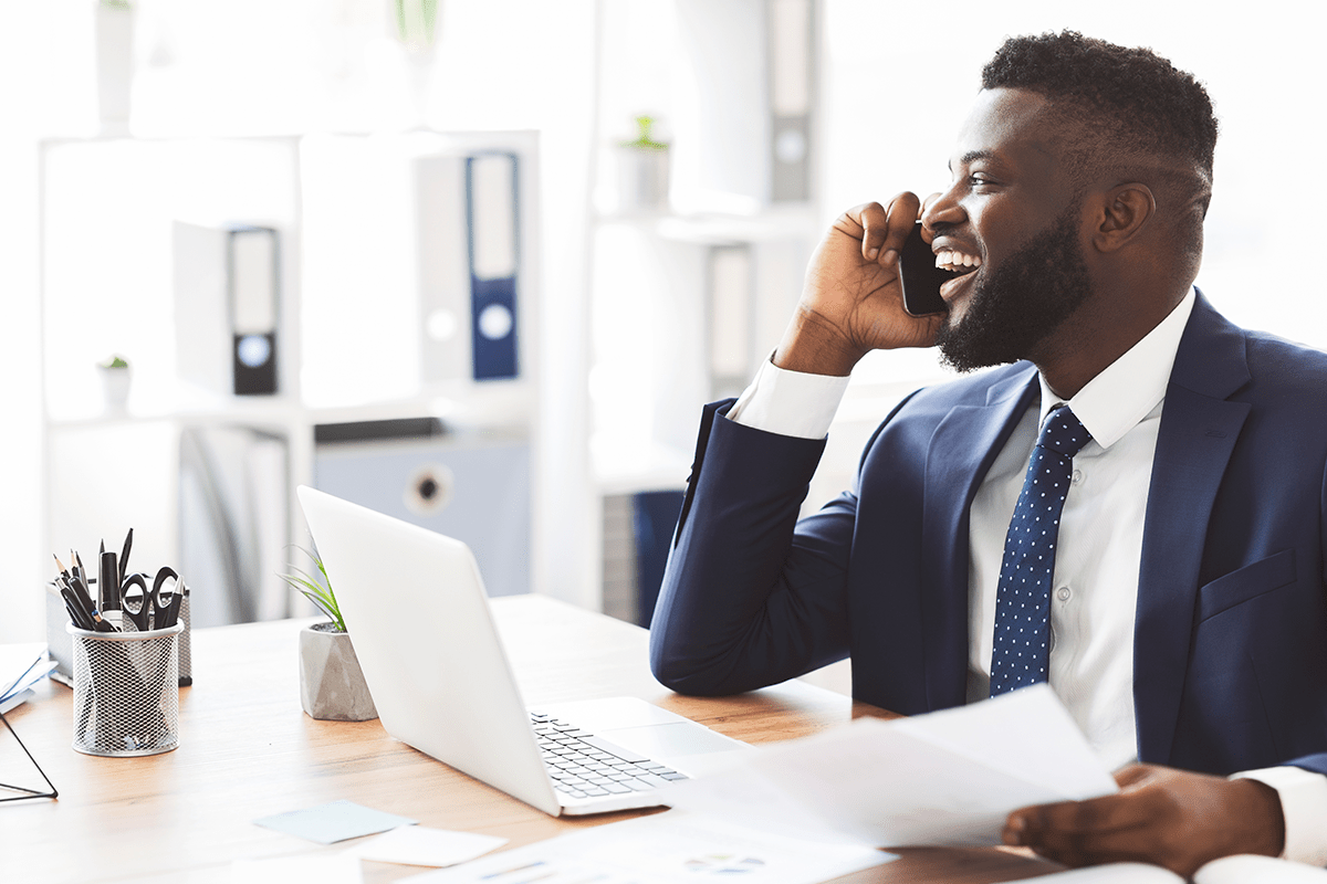 A businessman discusses his leadership goals on a phone call.