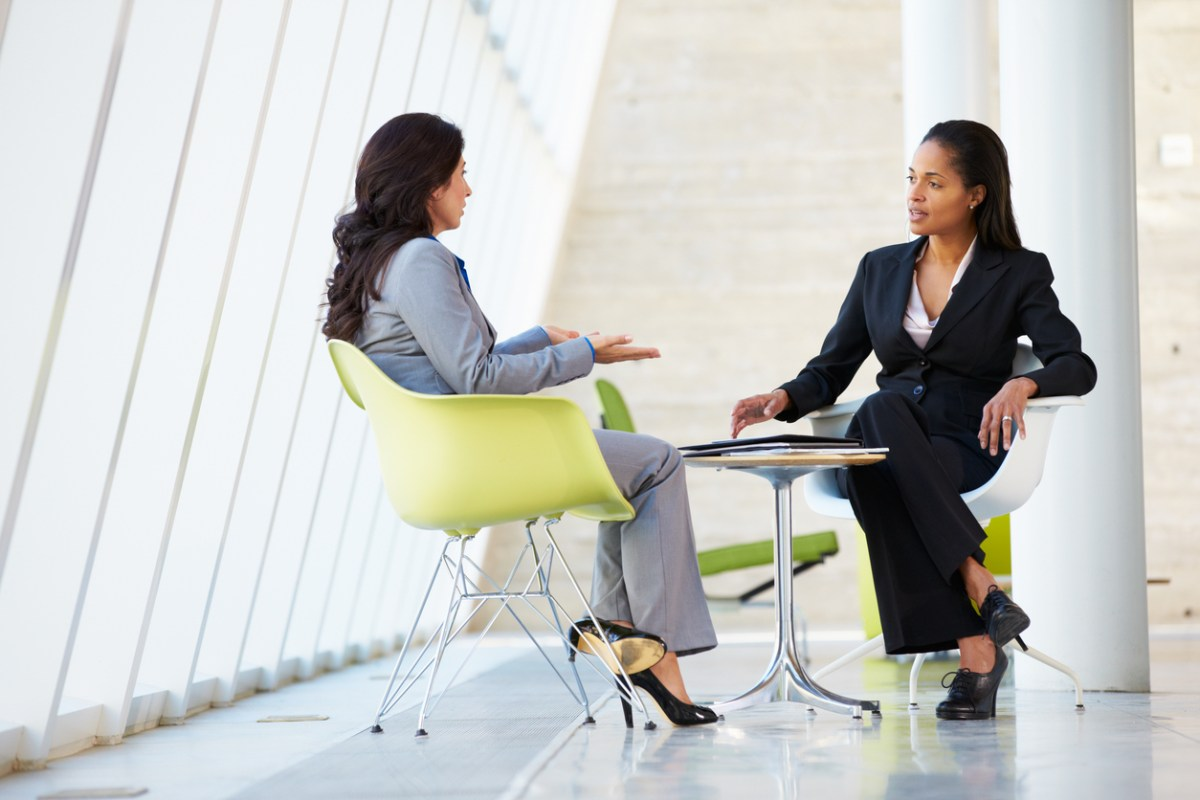 Two businesswoman at a table in modern office