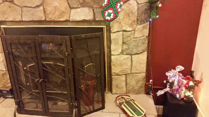 Christmas stocking crochet Joseph mantle fireplace lights toboggan