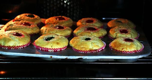 In the oven, another few more minutes till they are ready, all-in-one very easy almond cup cakes