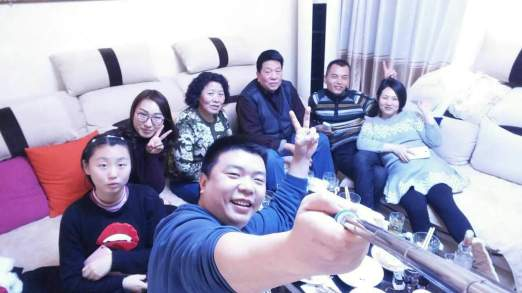 Bing with his wife, family and parents [centre] in Luo Yang near Peking