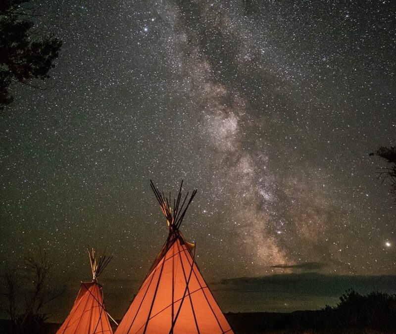 Tipis under the living sky in Treaty 4 Territory and the homeland of the Métis.