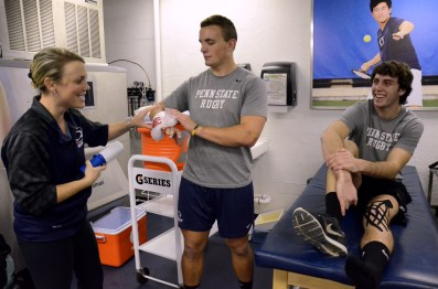 On Nov. 21, 2013 in the East Area Locker Rooms, Feury jokes around with his athletic trainer, Sarah Leslie, and rugby teammate Michael Marasco. Feury spends a lot of time with Marasco, frequently talking about how strong he is.