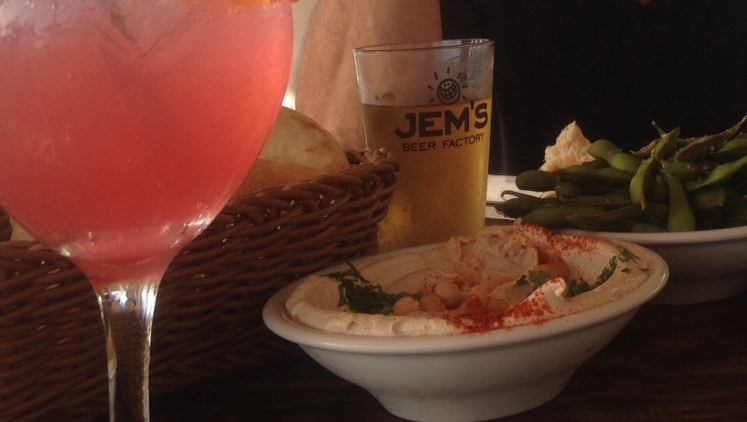 A dish of hummus in Tel Aviv, with cocktails.