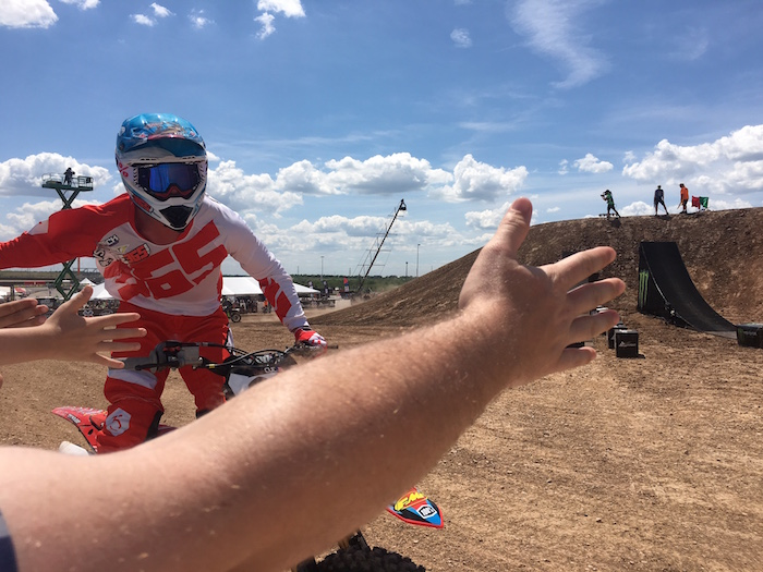 MotoX rider gives high fives to fans at X Games Austin 2016.