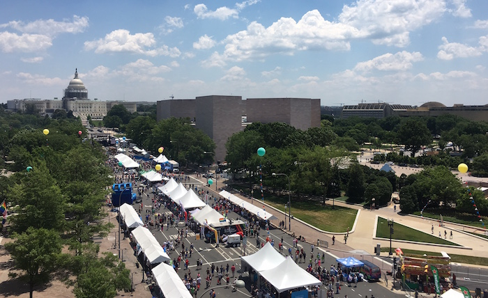 Street view of Washington D.C.'s Capital Pride Festival down Pennsylvania Avenue, toward the Capitol.