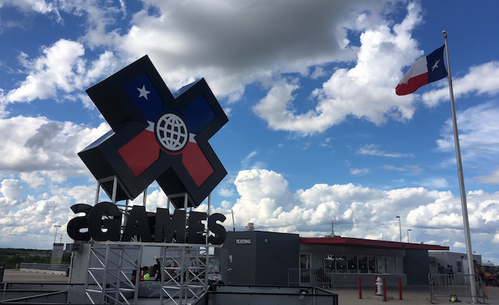 X Games Austin logo at entrance to Circuit of The Americas, next to Texas state flag.