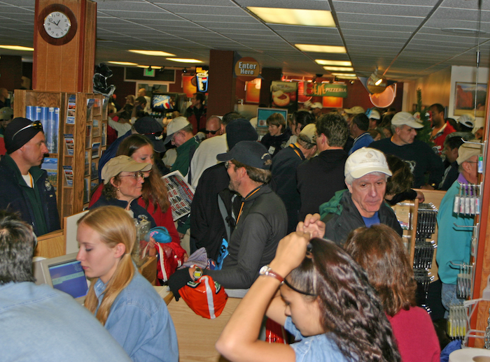 Crowds of people at Pikes Peak Summit take shelter from a storm at 2005 race.