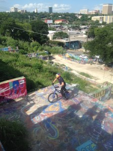 Looking down on cyclist Danny MacAskill as he jumps Austin's Baylor Street Art Wall
