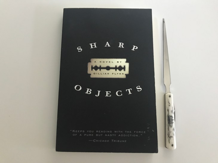 Cover of Gillian Flynn novel Sharp Objects with letter opener