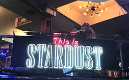 singing waitress above This is Stardust sign at Ellen's Stardust Diner in NYC