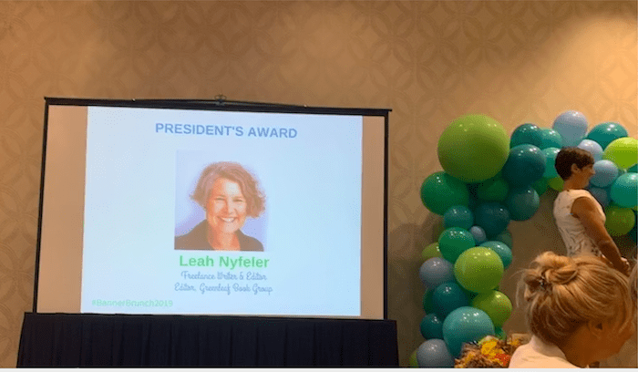 Slide showing 2019 President's Award Leah Fisher Nyfeler, Women Communicators of Austin