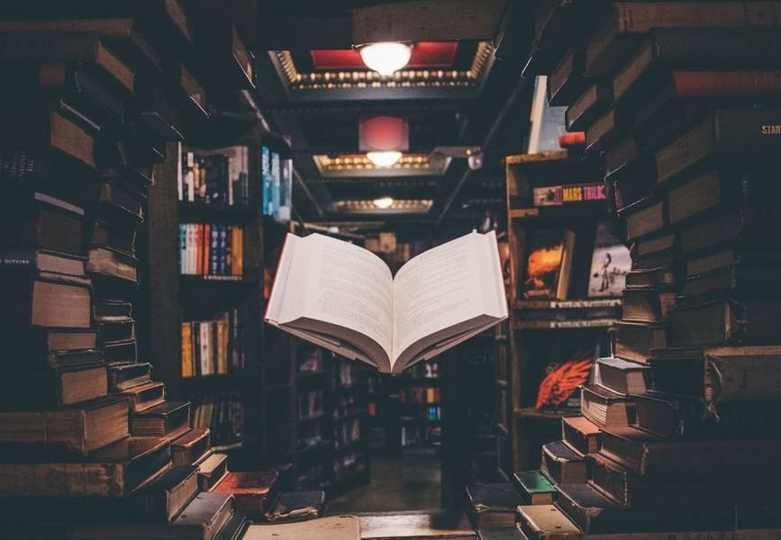image floating book surrounded by books copyright Jaredd Craig