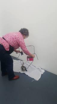 Jo installing her sculpture