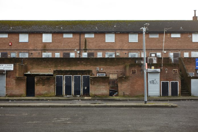 How can the empty housing crisis in England be improved?