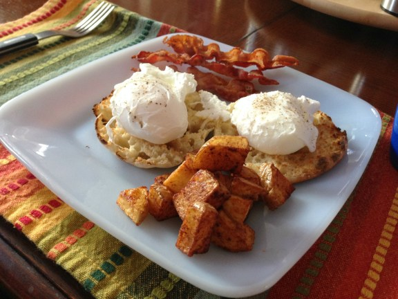 crispy bacon, poached eggs, potatoes and English muffin